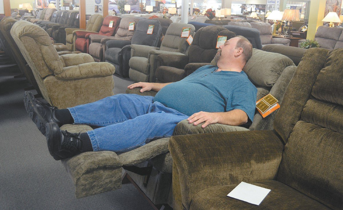 Tim Powell enjoys the comfort of a new recliner at Furniture Mart.