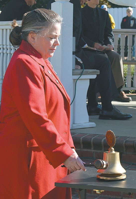Betsy Paul, the Regent of the Thomas Person Chapter of the DAR, rings a bell after hearing the name of every Person County resident who died in World War I. 20 Person County residents died in that war.