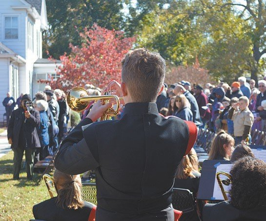 Roxboro Community School band member Carson Hester renders Taps at the close of Saturday's program.