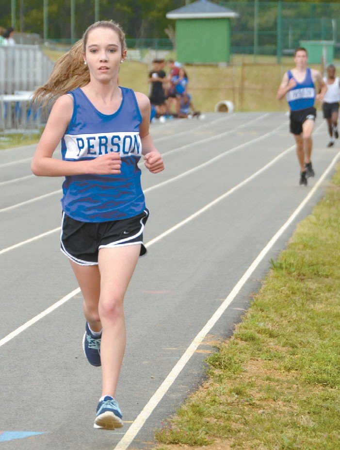 Magen Elliott is a top distance runner on the Person track team. She is shown here running the 1,600-meters during her sophomore year. FILE