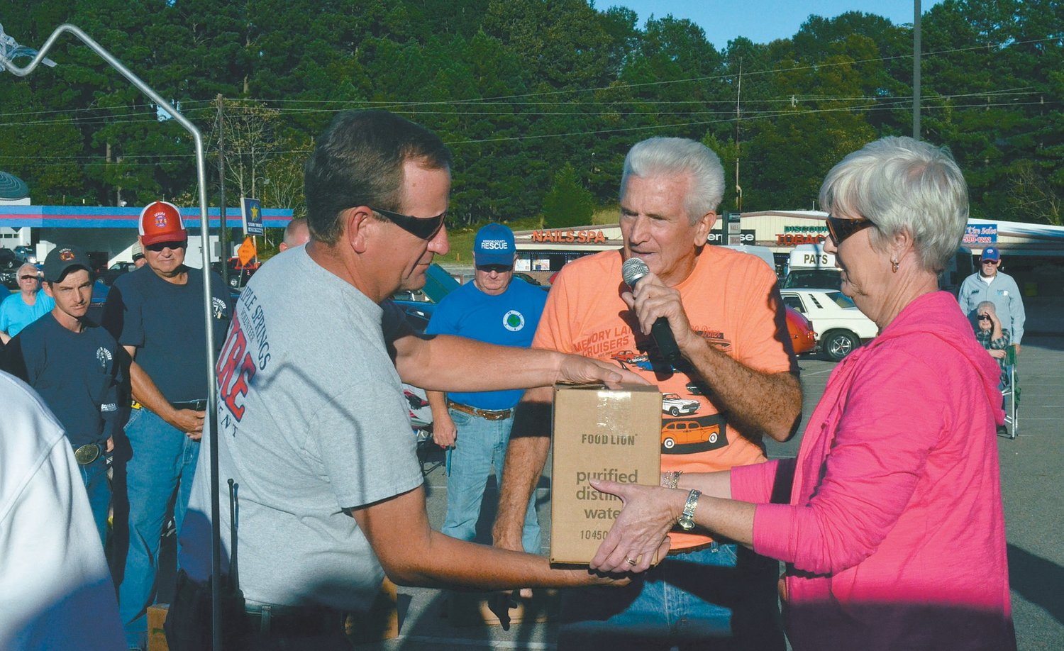 Firefighters from every department in Person County were given goodie bags courtesy of the Memory Lane Cruisers Car Club. PHOTOS BY JOHNNY WHITFIELD | COURIER-TIMES