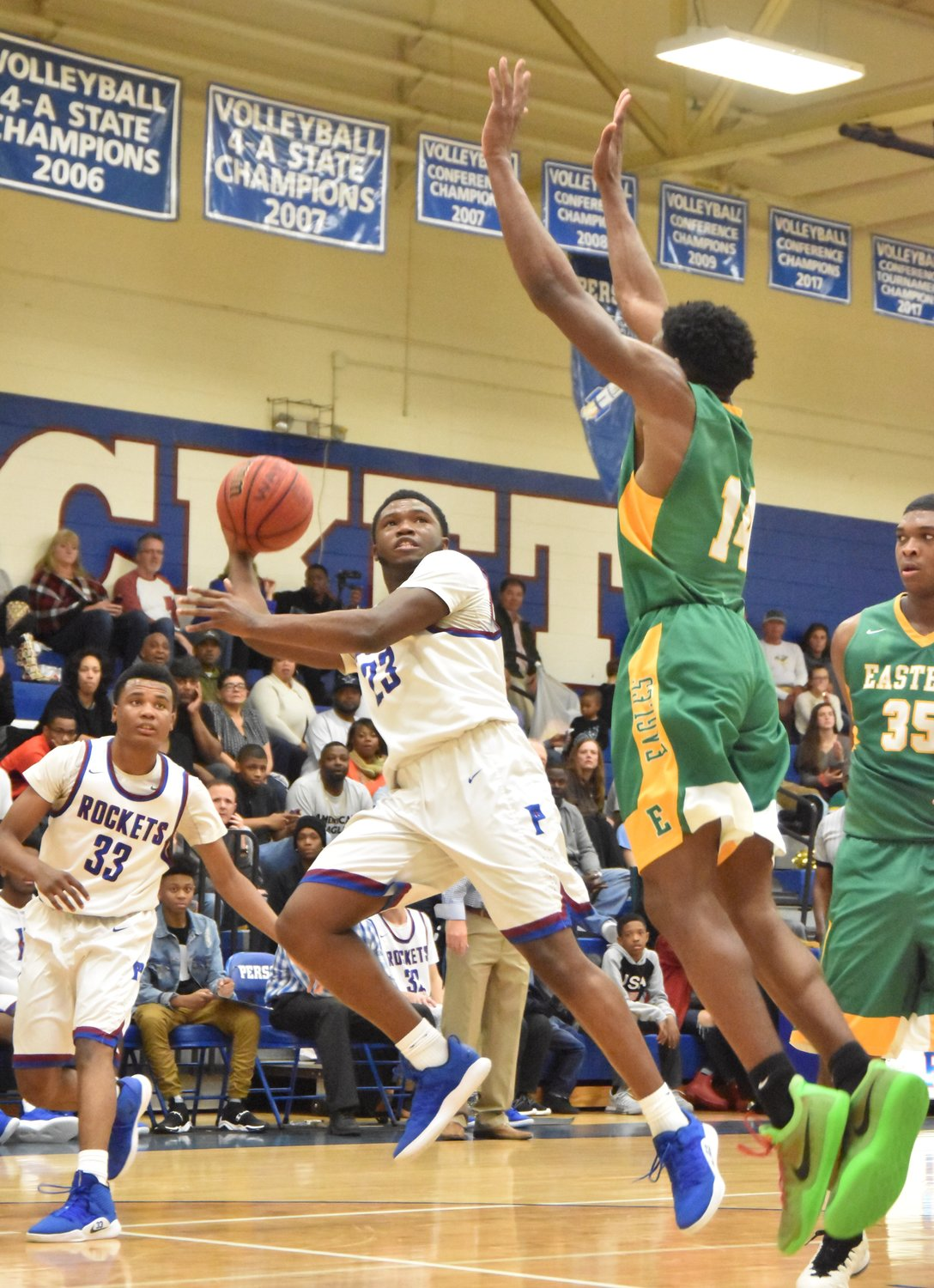 Person's Dre Newman launches a shot over an Eastern Alamance defender in the final minutes of Friday's game.