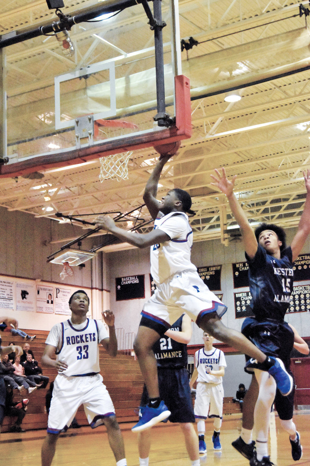 Kelly Snow | The Courier-Times.Person's Dre Newman gets to the rim on a drive during Tuesday's Mid-State tournament semifinal game against Western Alamance.