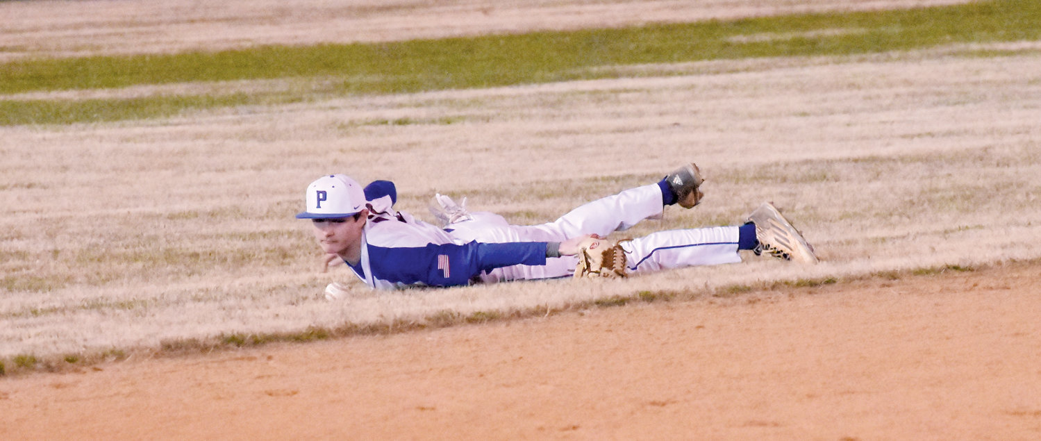 Kelly Snow | The Courier-Times .Person shortstop Cayden Goodwin dives after a grounder during Thursday's game against Rockingham County.