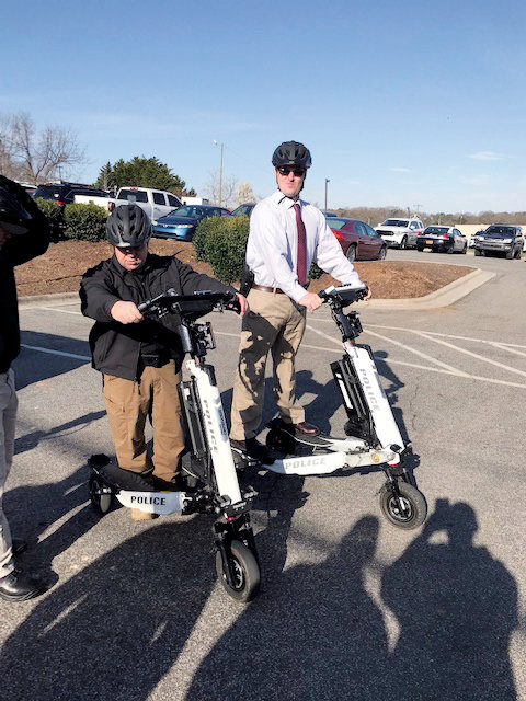 Last Thursday morning in the Roxboro Police Department parking lot Lt. Dan Walker (left) and Det. Jason Howe (right) had the opportunity to test out Trikke vehicles.