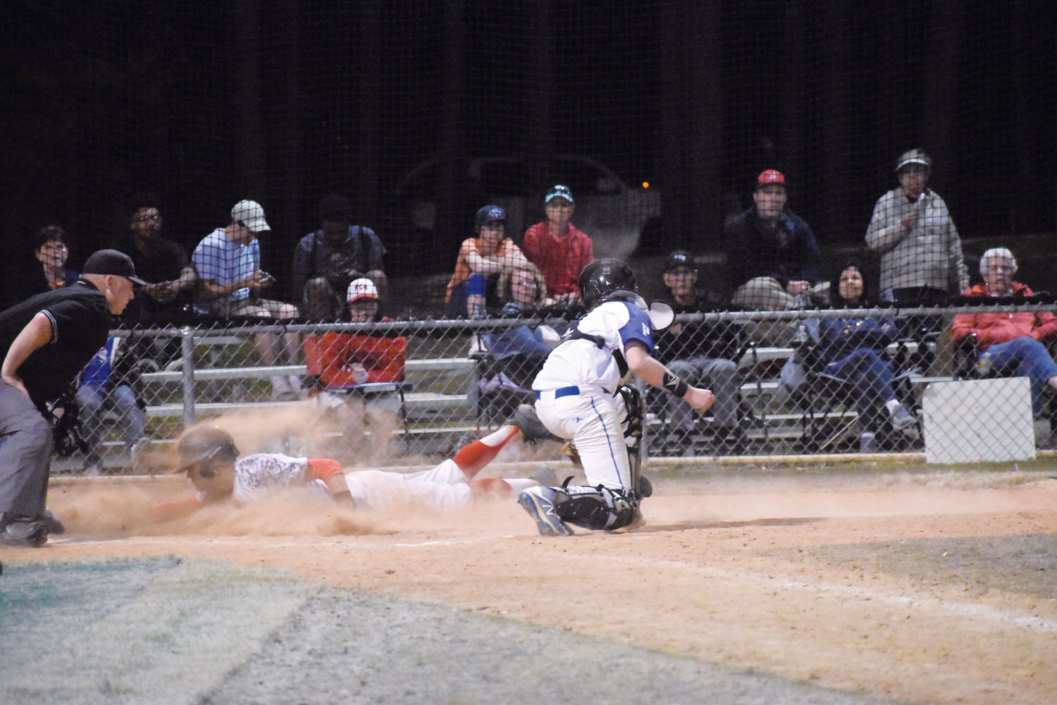 Kelly Snow | The Courier-Times.Roxboro Community School's Michael Clayton dlves home safely just in front of a tag in the seventh inning of Thursday's victory against Person. Clayton scored the eventual game-winning run and struck out all six batters he faced to get the victory on the mound.