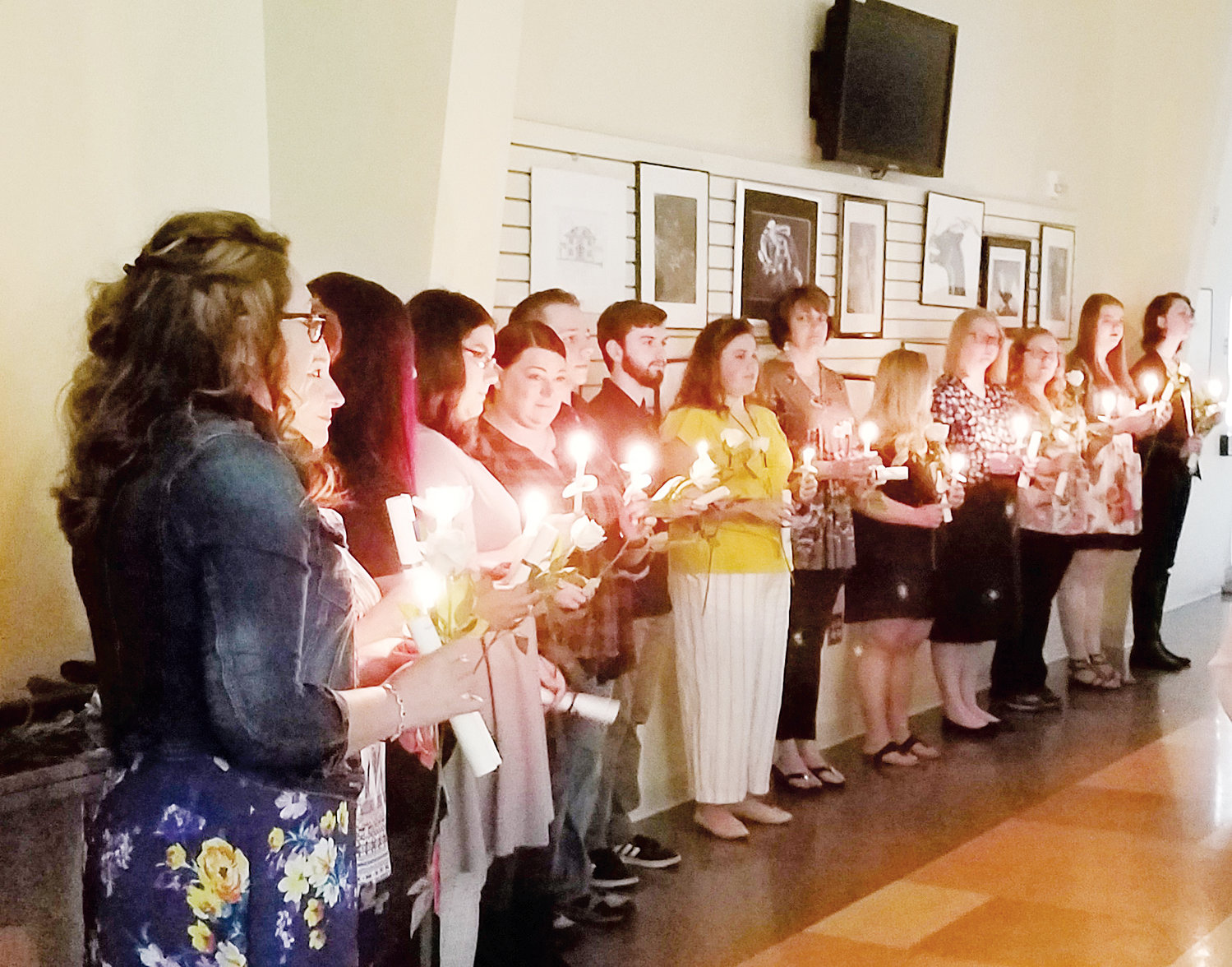New inductees in Phi Theta Kappa at Piedmont Community College take part in their induction ceremony last month.