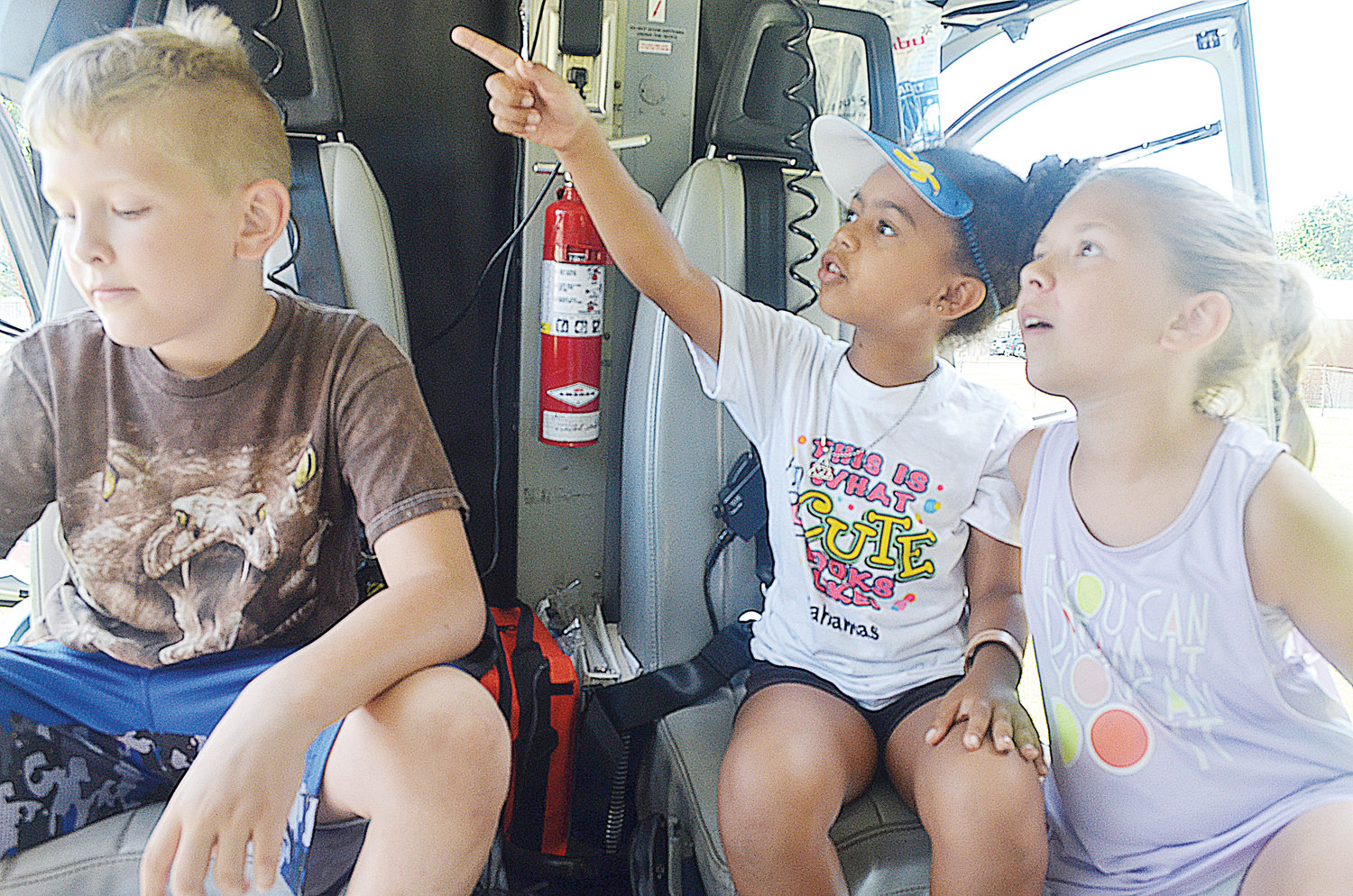 Saturday afternoon (left) Reed Stienbaugh, Abbey Coakley, Graceanne Stienbaugh got their first helicopter tour thanks to Duke Life Flight at Person Family Medical Center Inc. Community Family Fun Day. .