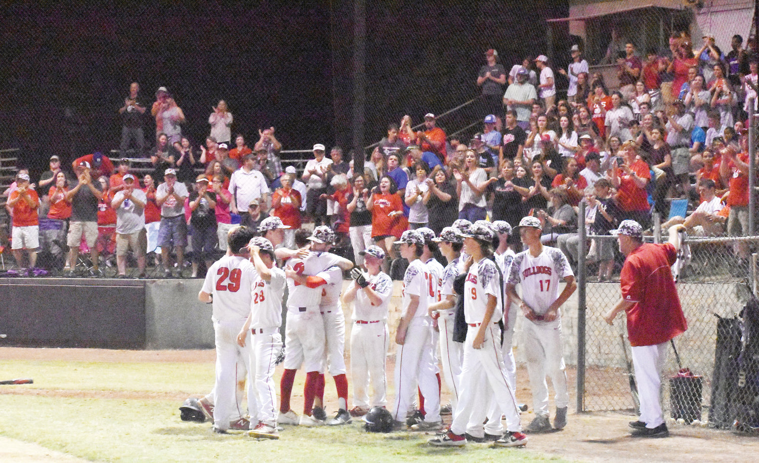 Kelly Snow | The Courier-Times.The Roxboro Community School baseball team gets a standing ovation from the home faithful at Optimist Park following the conclusion of game two of the 1A West regional final against Uwharrie Charter.