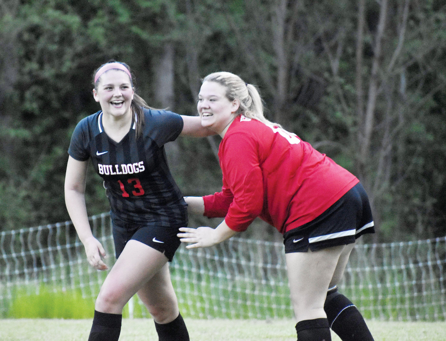 Kelly Snow | The Courier-Times.Roxboro Community School's Madison Dunkley (left) and Carly Grinstead are all smiles after defeating Voyager Academy, 2-1 in a key game during the season.