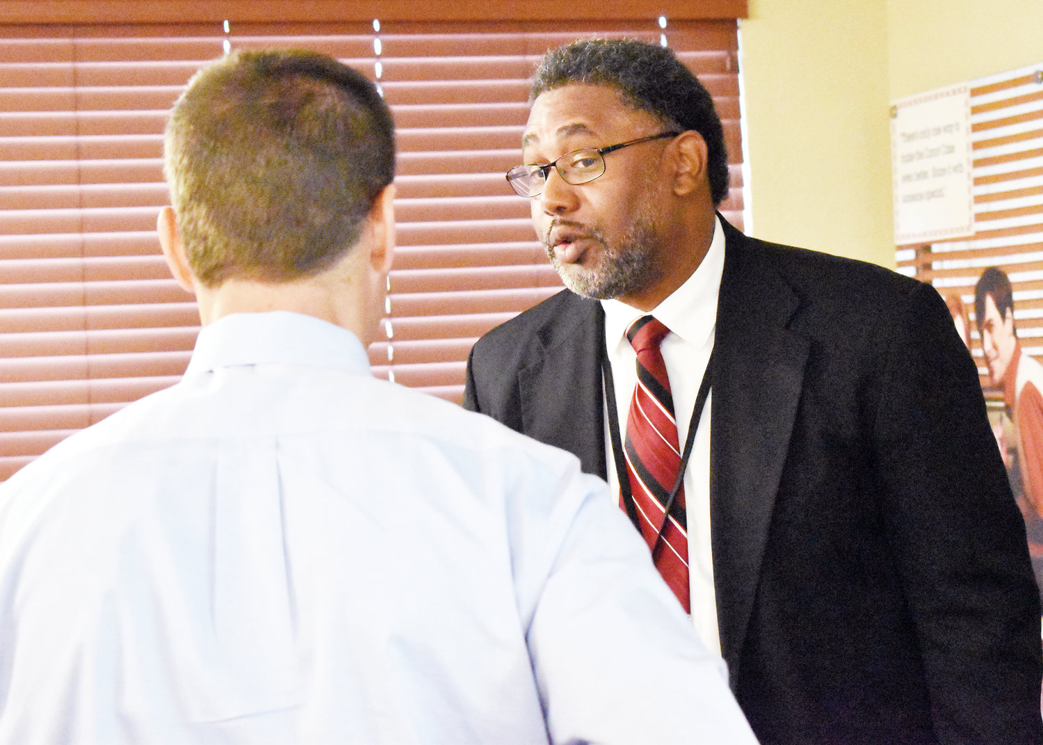 Roxboro Housing Authority Executive Director Felts Lewis, right visits with Roxboro Savings Bank president Keith Epstein following Tuesday morning's chamber breakfast.