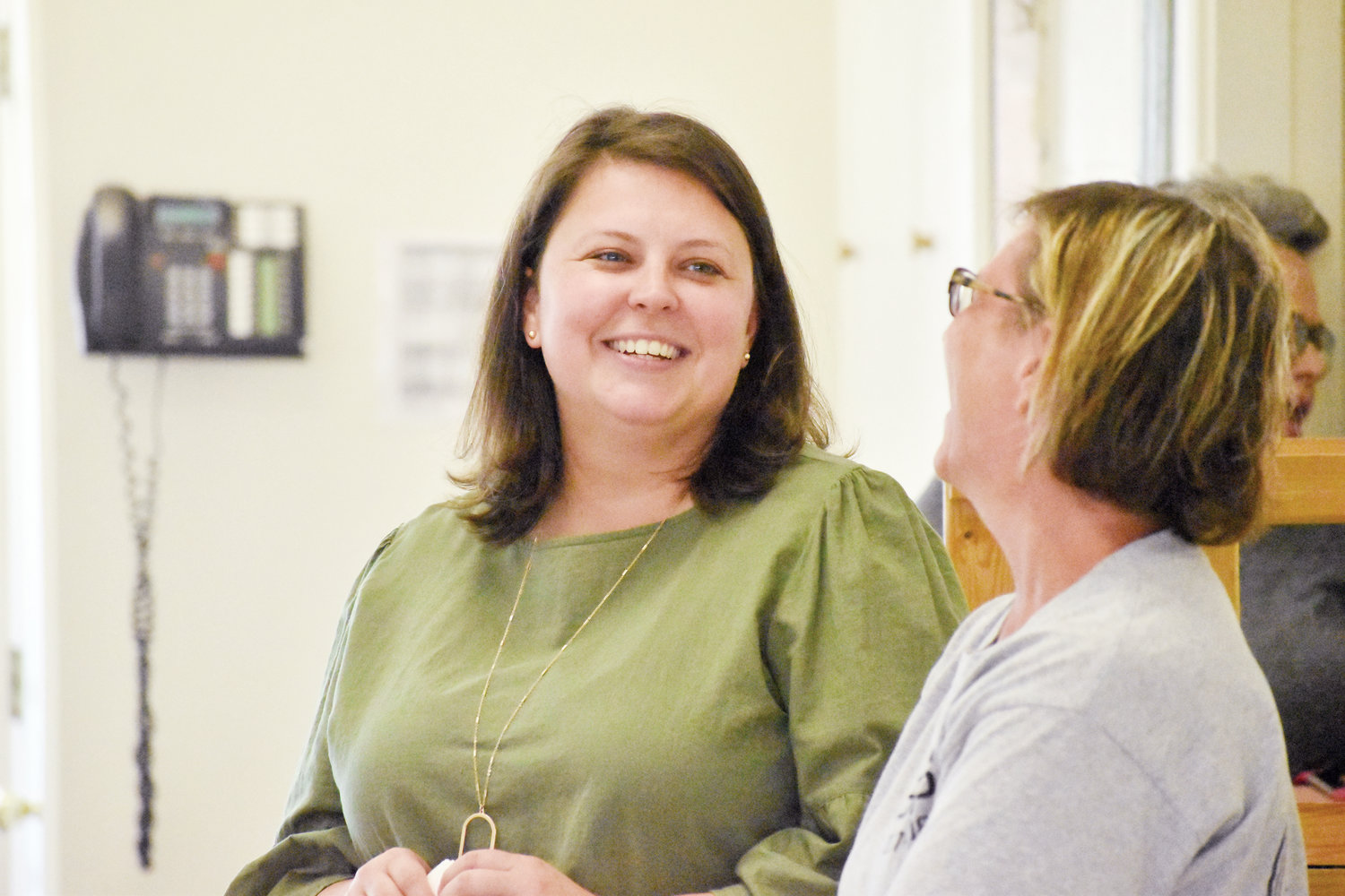 New Bethel Hill Charter School principal Jessica Poole, left, shares a laugh with fourth-grade teacher Nicole Chalk during a meet and greet at the school.