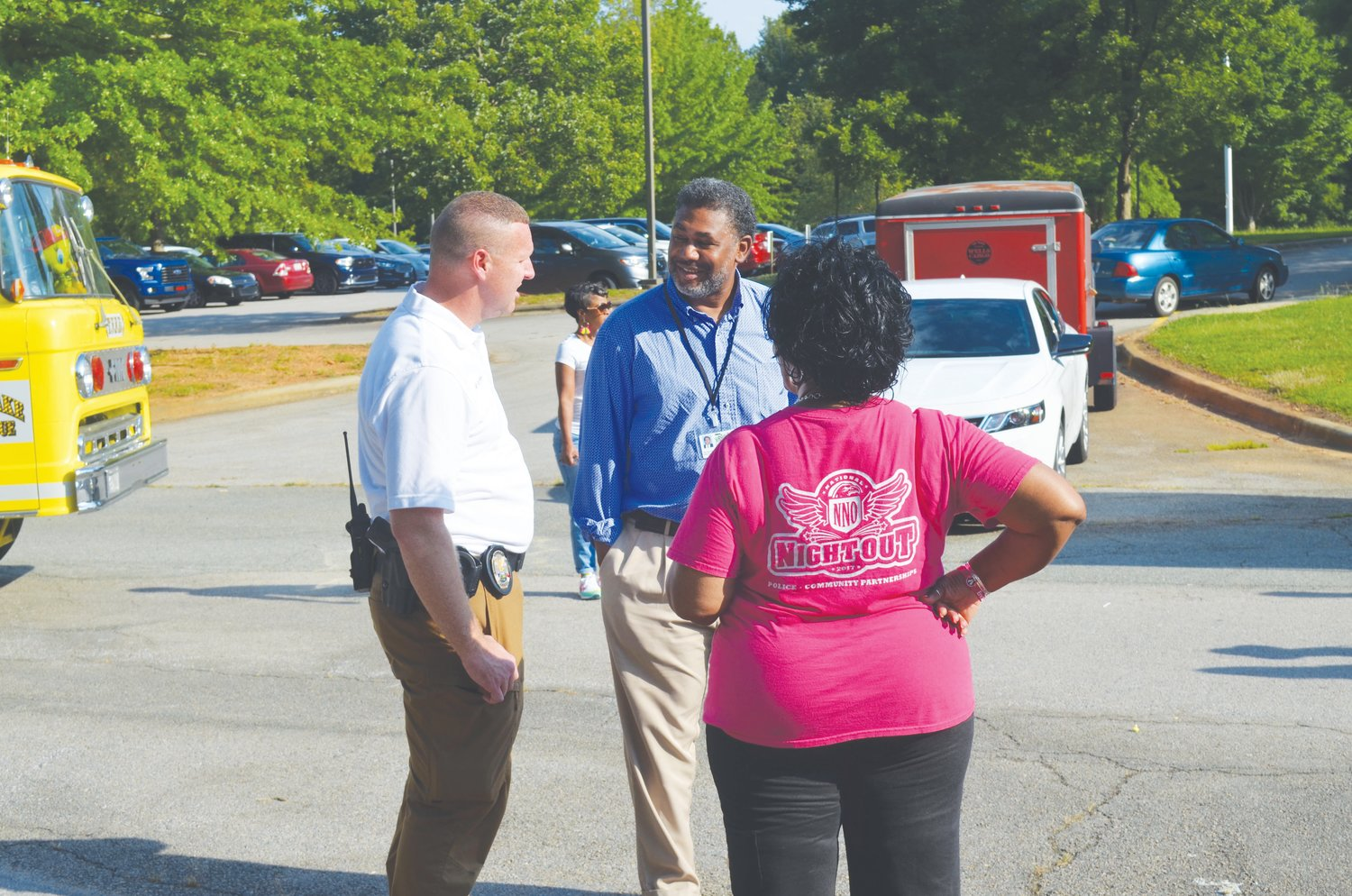 Roxboro Police Chief David Hess, MADD chapter leader Ollie Jeffers and Roxboro Housing Authority Executive Director Felts Lewis talk at National Night Out.