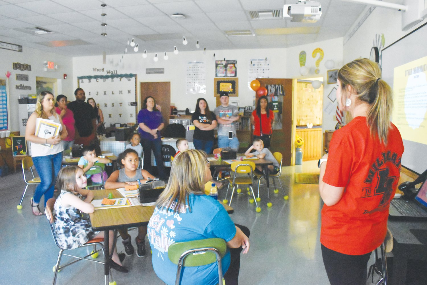 Bethel Hill first-grade teacher Samantha Morris explains to students and parents what they can expect when the school year kicks off on Monday.