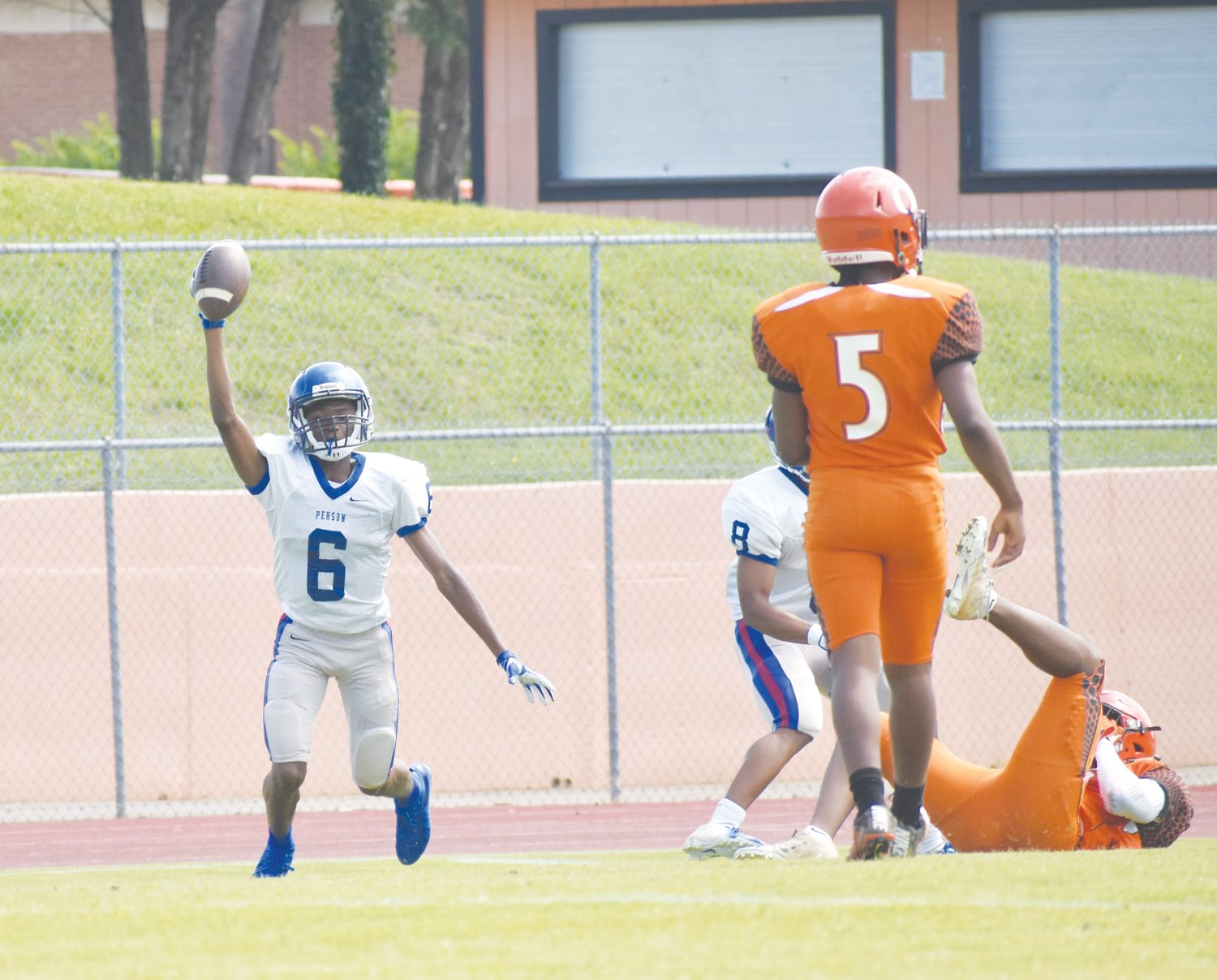 Kelly Snow | The Courier-Times.Person High School football player Jailin Smith shows the ball after making an interception during Saturday's scrimmage against Orange. Smith had two interceptions in the scrimmage..