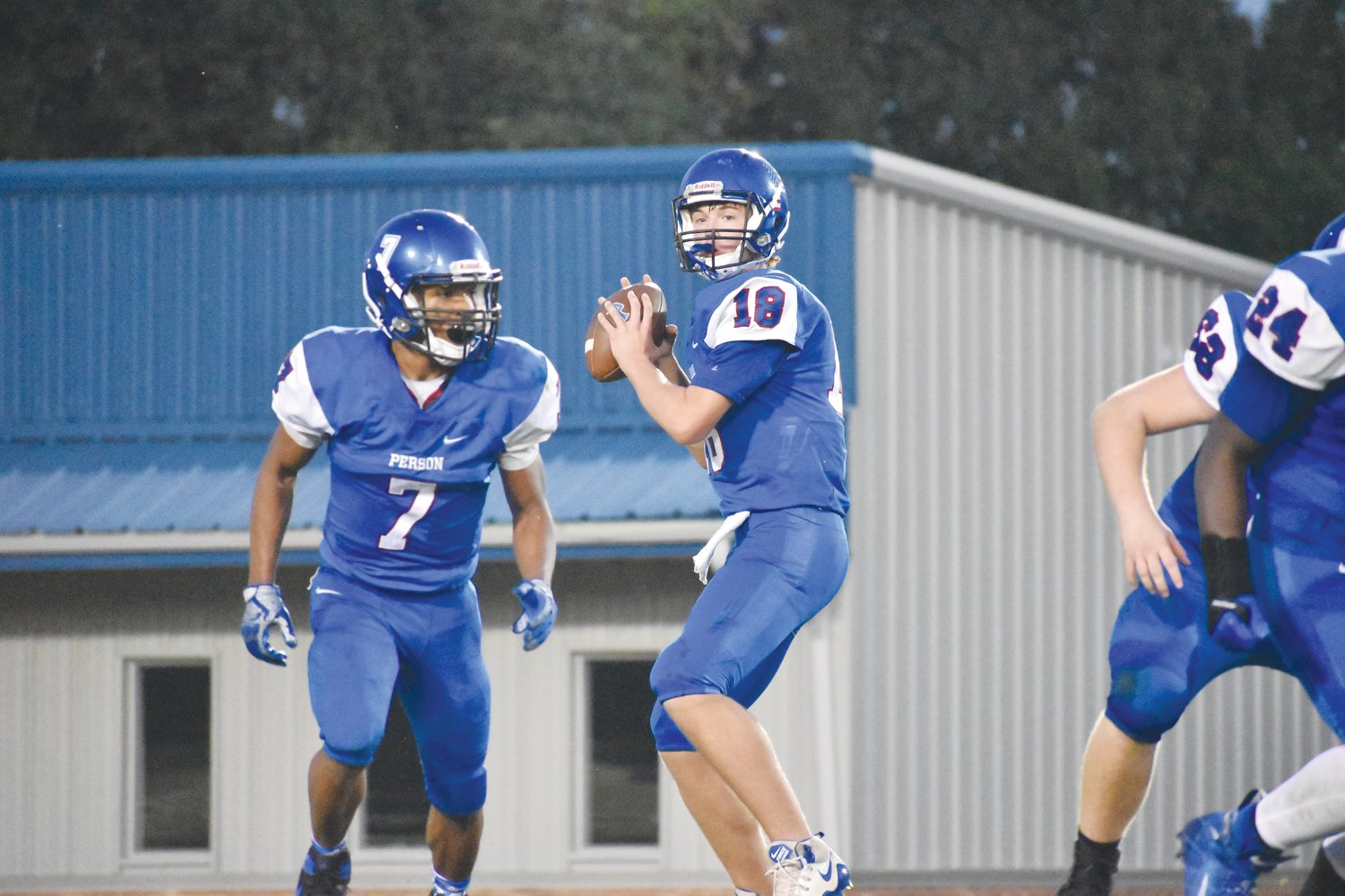 Ridge Clayton looks downfield as he sets up to pass in Friday night's game against Riverside.