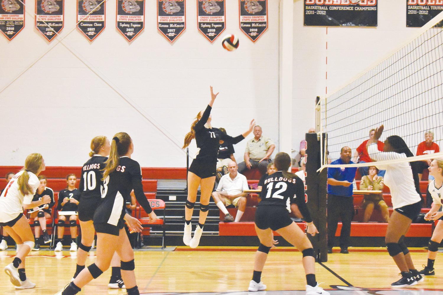 Abby Lewis leaps for the ball during the decisive fifth set against East Wake Academy.