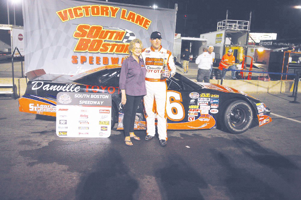 South Boston Speedway 2019 NASCAR Whelen All American Series Late Model Stock Car Division champion Peyton Sellers of Danville, Virginia (right) is congratulated by South Boston Speedway General Manager Cathy Rice following Saturday night's GCR Presents LS Tractor USA NASCAR Late Model Twin 75s at South Boston Speedway.