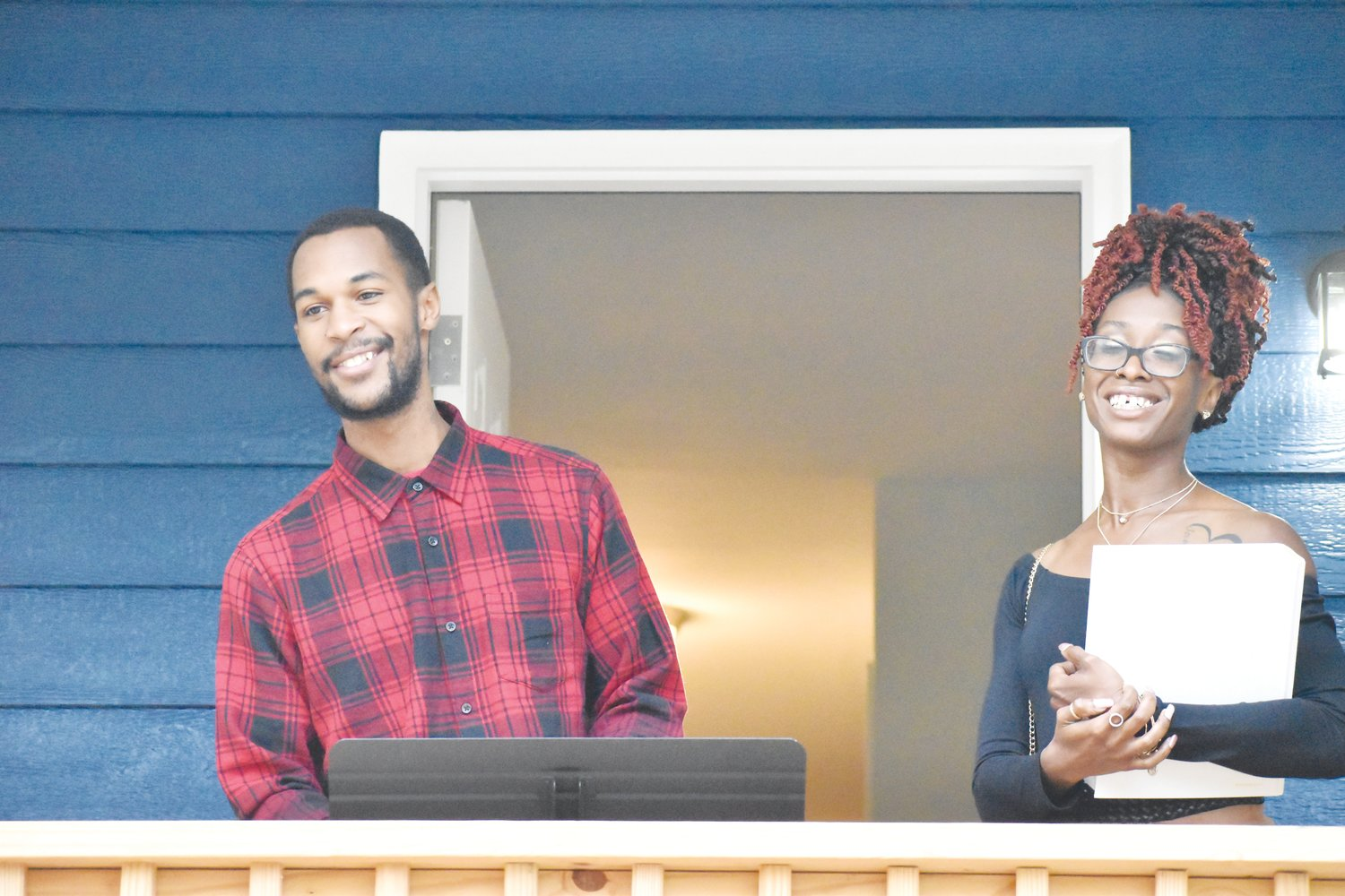 Rondetta Morris, right, and her brother James are all smiles at the close of Saturday's dedication of a home constructed by Person County Habitat for Humanity.
