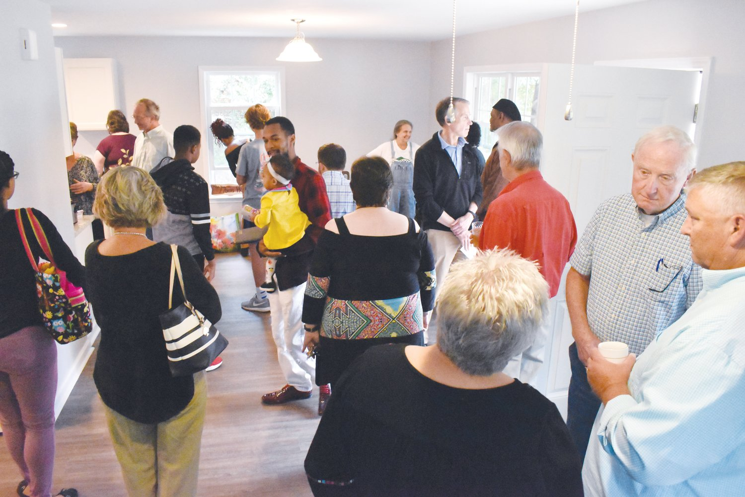 A large crowd gathered Saturday afternoon for the dedication of the newest Habitat for Humanity home in Roxboro.