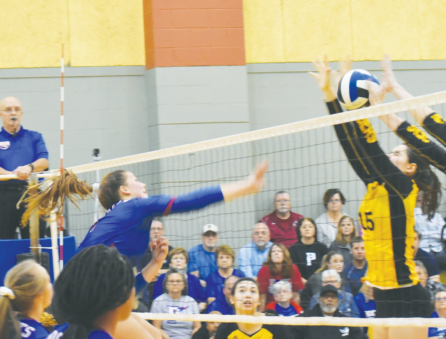 Rockets junior Madison Dunkley (1) goes for the kill against Chapel Hill's front row.