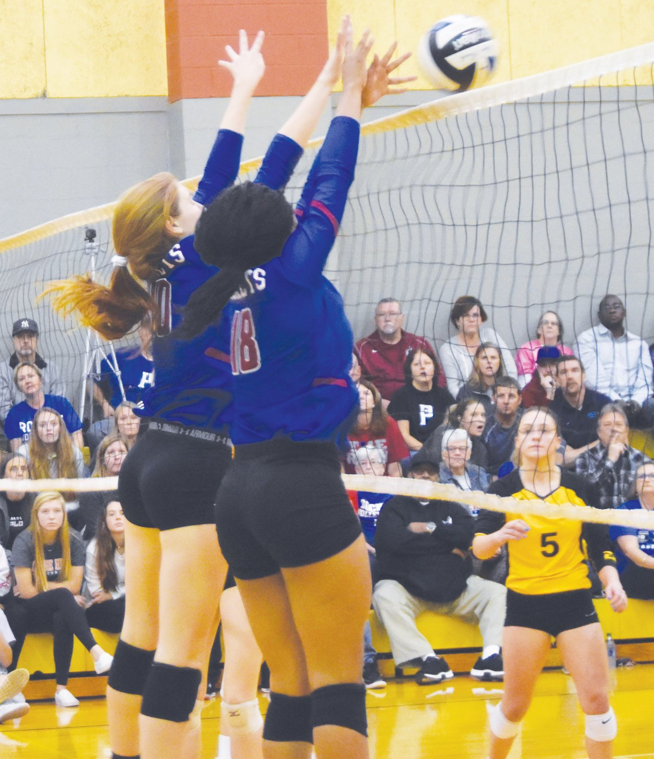 Rockets junior Aaliyah Jones (18) and captain Karoline Cox (10) time their jump perfectly to record the block against the Tigers.