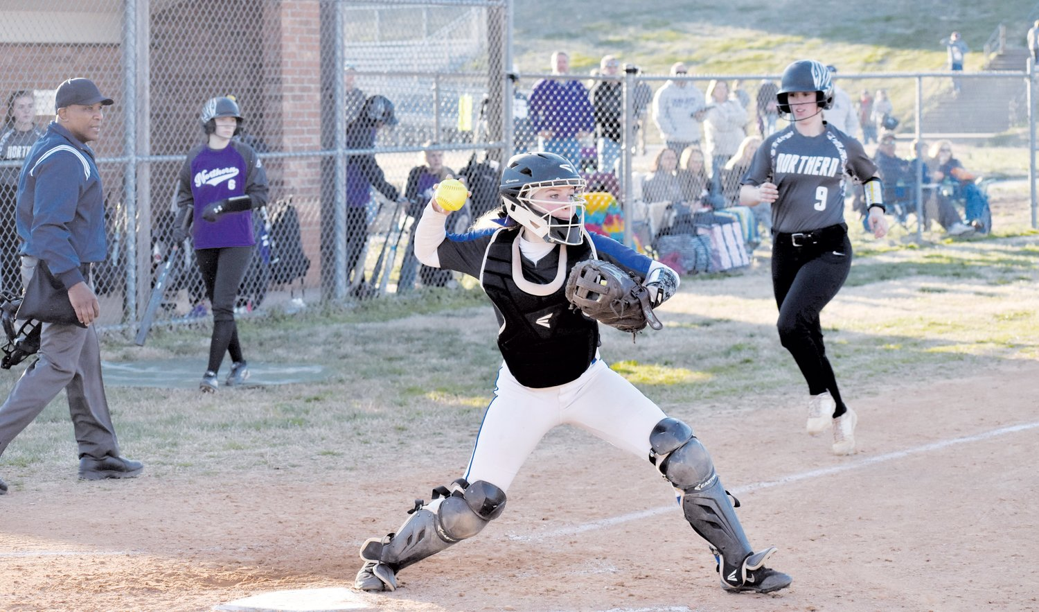 Person catcher Payten Pearsall fires to first base to complete a 1-2-3 double play during a game last year agaisnt Northern Guilford. The Lady Rockets' 2020 season begins in three days, as Person travels to Southern Alamance, where they take part in a multi-team jamboree.