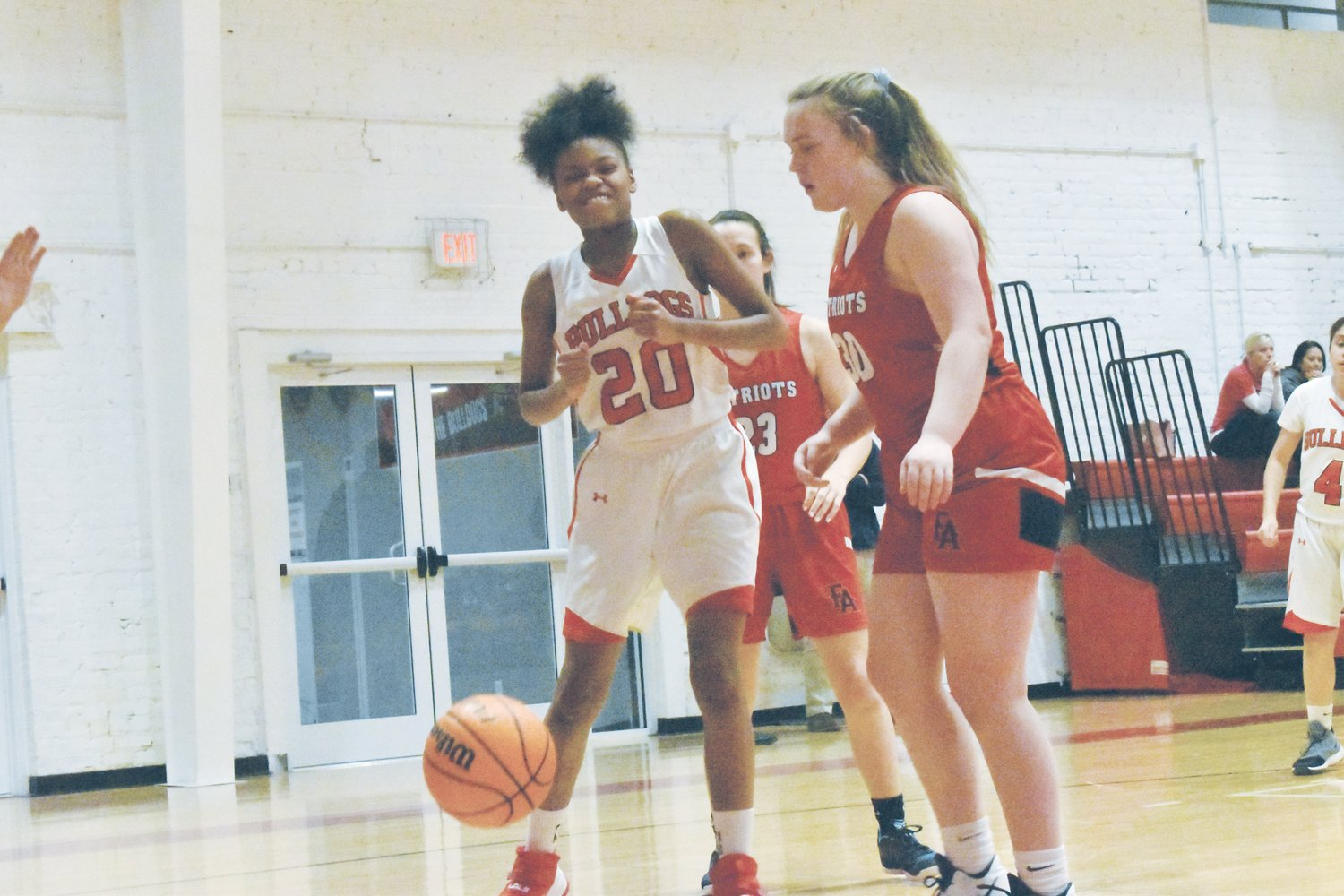 The Lady Bulldogs' Michayaj Jay (left) reacts to the ball going out of bounds in Roxboro Community School's Jan. 21 contest against Franklin Academy. Jay earned all-conference honors as the Lady Bulldogs' top shot blocker, swatting away 40 attempts.