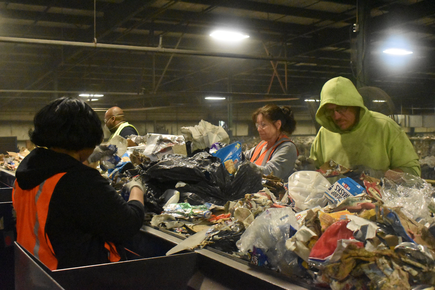 From left, Latasha Parrish-Poteat, Michael Stephens, Gloria Drollinger and William Powell sort through recyclable material stored at the Person County Recycling Center.
