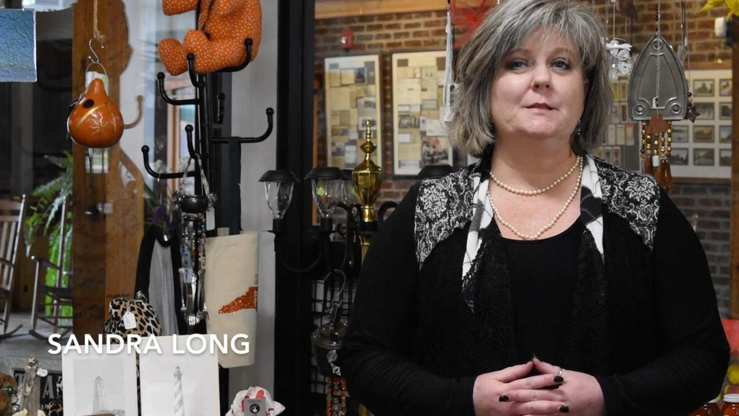 Sandra Long, at Artisan's Emporium, is one of nearly two dozen people featured in a video that promotes local spending.