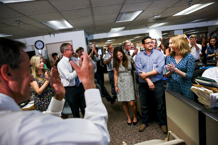 Cara Fitzpatrick (right), Michael LaForgia and Lisa Gartner of the Tampa Bay Times are applauded after the announcement that their work had won a Pulitzer Prize on Monday.