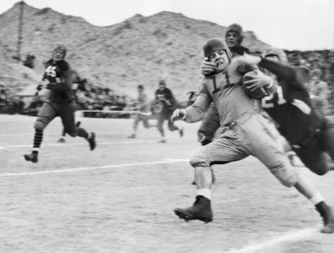 This photo, from the close of the first season of the AP poll, shows Texas Tech's famed Elmer Tarbox, No. 21, at extreme right, giving the well-known neck tie tackle at the Sun Bowl in El Paso, Texas, on Jan. 2, 1937.