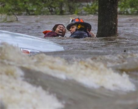 GRAND PRIZE - SNPA Photo Contest: Little Rock Fire Capt. Steve Kotch, right, and an unidentified woman stumble and fall into the water as Kotch rescues her from her flooding car.