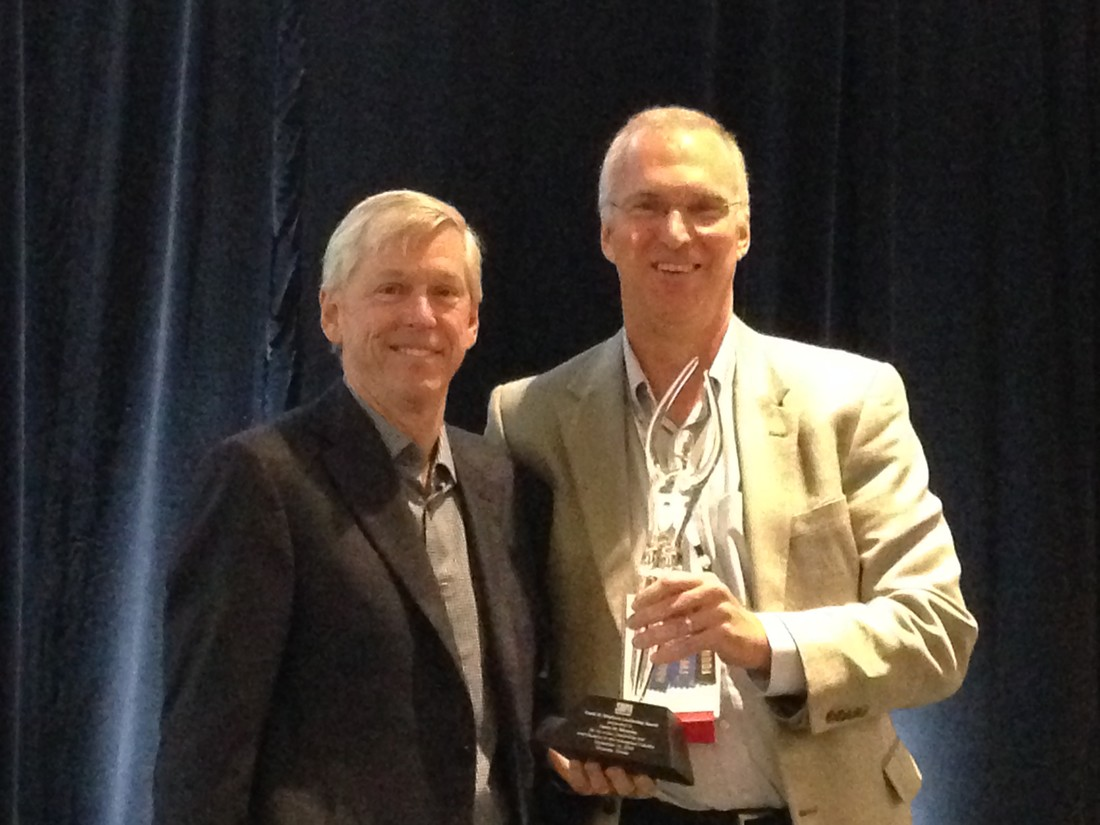 James M. Moroney of The Dallas Morning News is presented the 2016 Frank W. Mayborn Leadership Award by SNPA President David Dunn-Rankin.