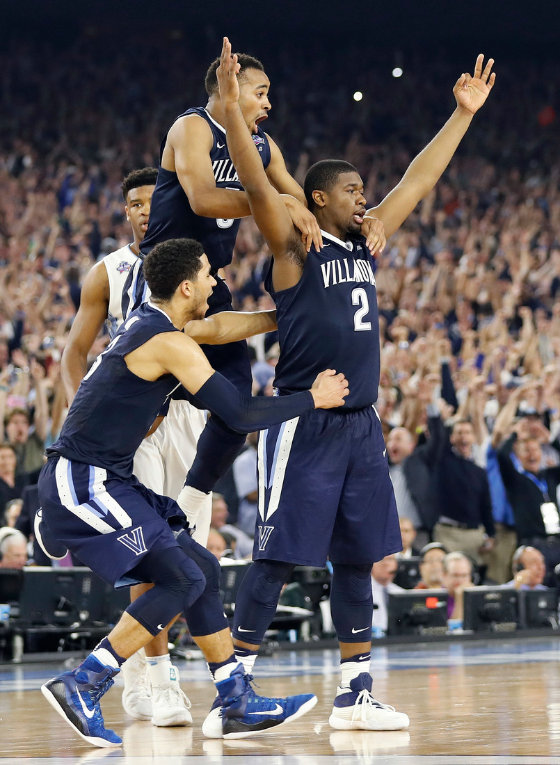 Villanova forward Kris Jenkins (2) celebrates with teammates after the NCAA Final Four tournament college basketball championship game against North Carolina Monday, April 4, 2016, in Houston. Villanova won 77-74.