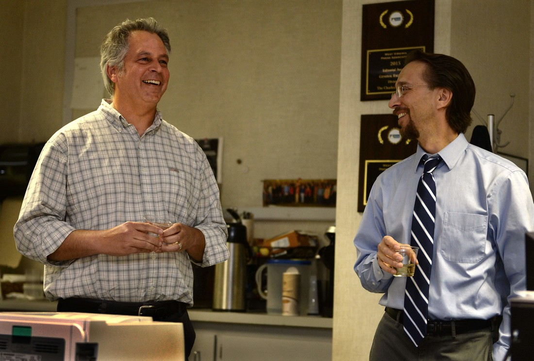 Gazette-Mail reporter Eric Eyre (left) talks with Executive Editor Rob Byers after Eyre won the 2017 Pulitzer Prize for investigative reporting.