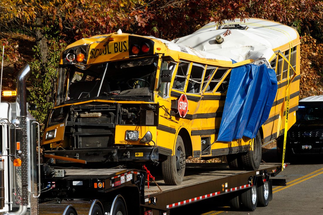 A wrecker removes the school bus from the scene of a crash on Talley Road on Tuesday, Nov. 22, 2016, in Chattanooga, Tenn. The Monday afternoon crash killed at least 5 elementary schoolchildren and injured dozens more. The NTSB has been called in to help investigate.  (Photo by Doug Strickland / Chattanooga Times Free Press)