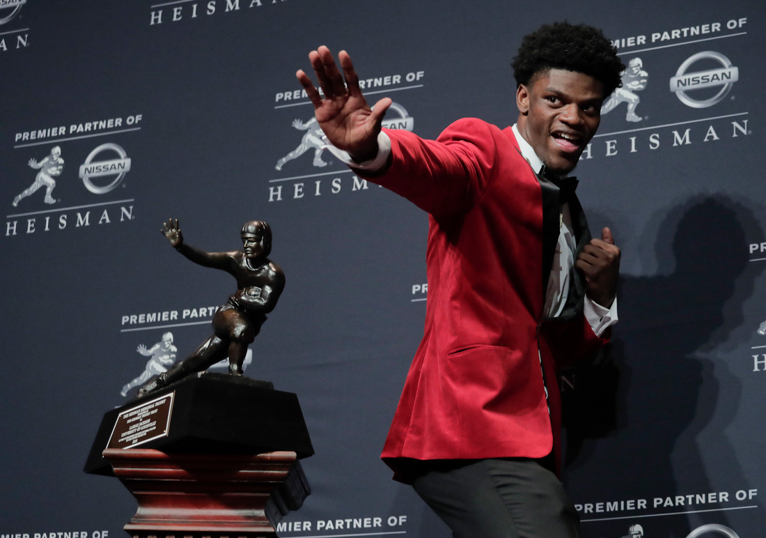 Louisville's Lamar Jackson poses with the Heisman Trophy after winning the Heisman Trophy award Saturday, Dec. 10, 2016, in New York. (AP Photo/Julie Jacobson)