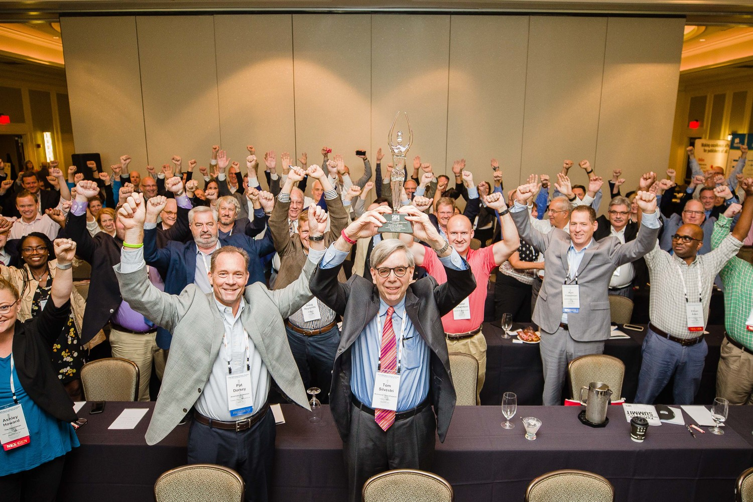 Reaching for the stars:  SNPA members raise their arms with Mayborn Award recipient Tom Silvestri in salute and celebration of our industry.