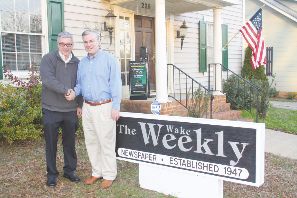 Wilson Times Co. President and Publisher Keven Zepezauer, left, is pictured with Todd Allen, who served as publisher and executive editor of the Wake Weekly newspapers.