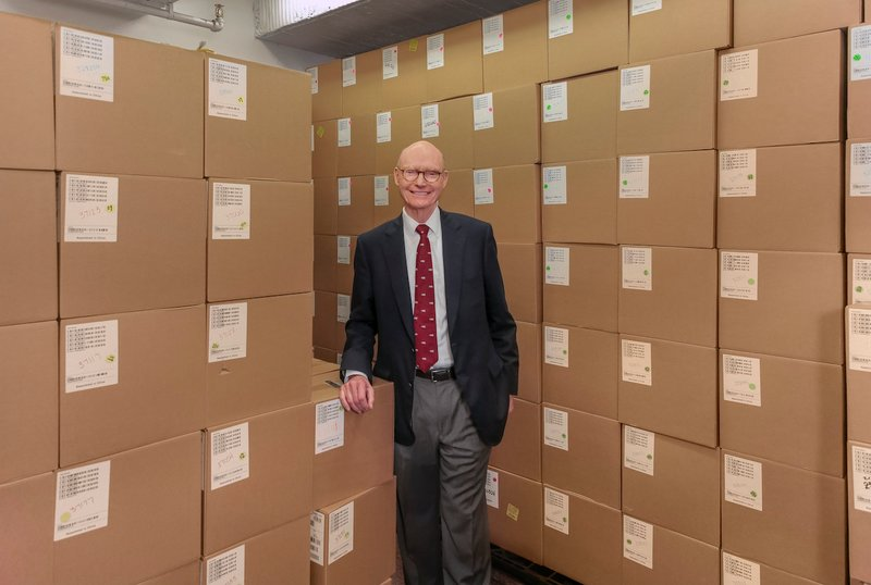 Walter Hussman, publisher of the Democrat-Gazette, recently stands in front of boxes containing thousands of iPads. (Arkansas Democrat-Gazette/JOHN SYKES JR.)