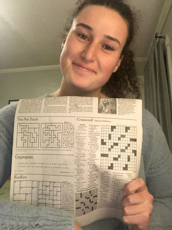 Nantucket High School graduate Luci Bresette with a copy of the New York Times crossword puzzle she helped create.