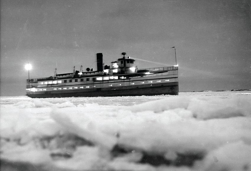 Steamship Nobska approaching the wharf at night through snow and ice Jan. 3, 1961.