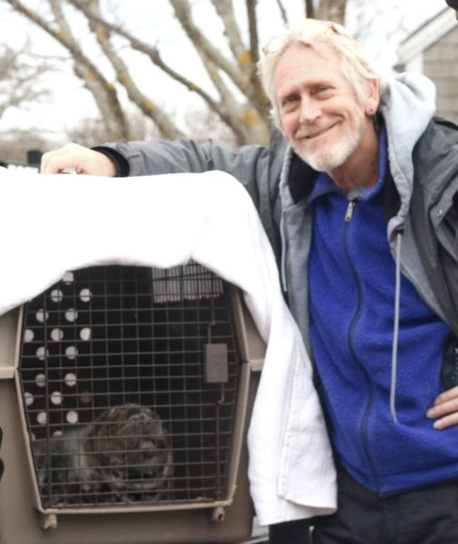 Scott Leonard with an injured seal pup rescued by the Marine Mammal Alliance Nantucket.