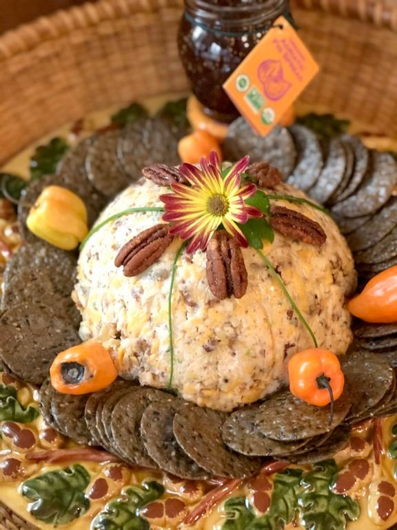 This Halloween Cheddar Cheese Ball shaped like a pumpkin is an adaptation of a popular Southern appetizer.