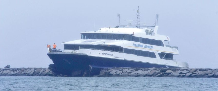 """Crew members stand by on the bow of the M/V Iyanough high-speed ferry, which punched through the Hyannisport breakwater returning from Nantucket June 16, 2017. The U.S. Coast Guard ruled that """"loss of situational awareness"""" by the crew on the bridge, the pilot's 10-month absence from serving on the fast ferry and the weather were among the factors causing the crash."""