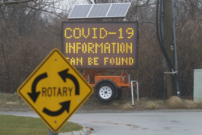 This digital billboard at the Milestone Rotary advises motorists to visit the town website for information on coronavirus.