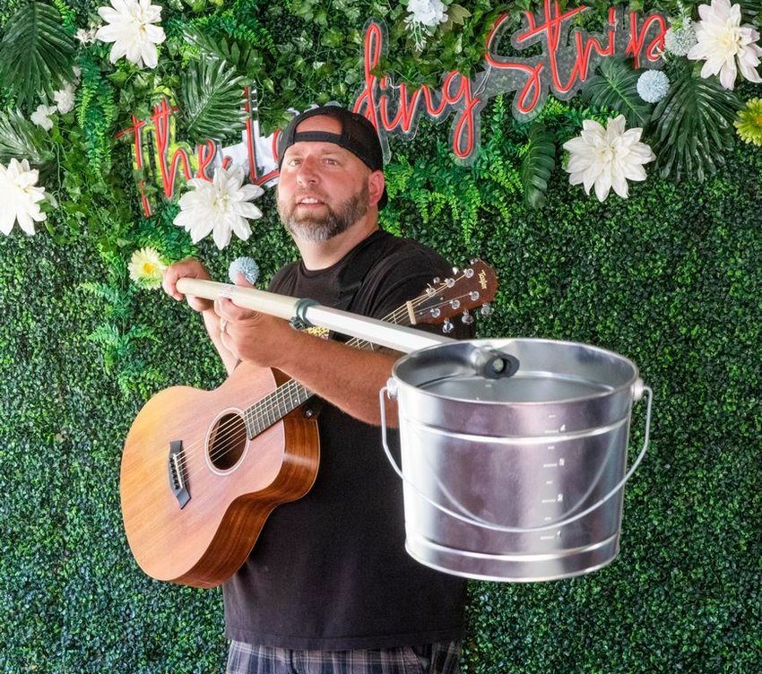 Brian Glowacki, with his tip bucket on a socially-distanced pole, has been playing gigs at The Saltbox Tavern and Table this summer.