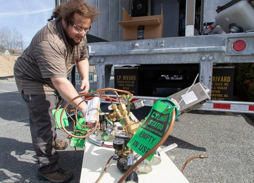 Mike Ansara of Build Health International adds a medical-gas regulator to a truckload of useable medical equipment headed from the former Nantucket Cottage Hospital to facilities in need around the world.