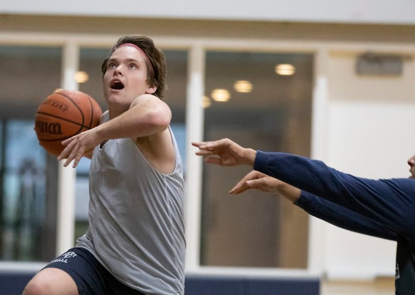 Senior Joel MacVicar drives to the hoop in practice this week. The Whalers are scheduled to open the season Monday against Cape Cod Academy.